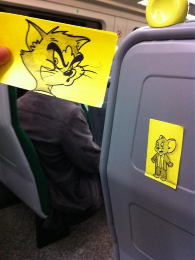 Amazing pics of train passengers with cartoon heads by October Jones