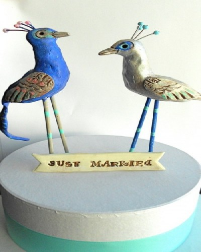 Unusual wedding cake toppers